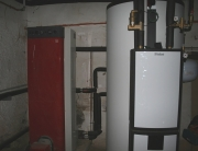 Fogón con paila para sistema ACS y calefacción por radiadores