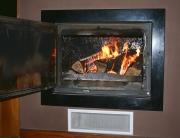 Fogón con paila para ACS y calefacción por radiadores